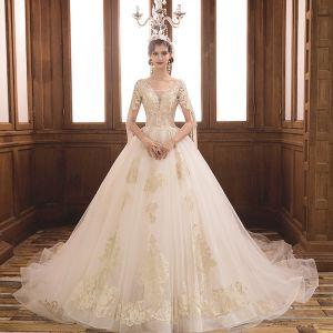 Lyx Champagne Bröllopsklänningar 2019 Balklänning V-Hals Korta ärm Halterneck Appliqués Spets Beading Tassel Glittriga / Glitter Tyll Cathedral Train Ruffle