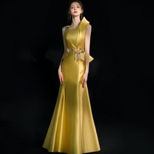 Unique Gold Abendkleider 2018 Meerjungfrau Applikationen Perlenstickerei Quaste Kristall Strass Rundhalsausschnitt Rückenfreies Ärmellos Lange Festliche Kleider
