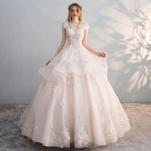 Chic / Beautiful Champagne See-through Wedding Dresses 2018 Ball Gown Scoop Neck Cap Sleeves Backless Appliques Flower Sequins Pearl Ruffle Cathedral Train