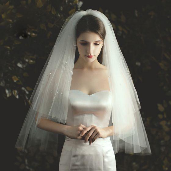 Romantisch Ivoor Korte Bruidssluier 2020 Tule Kralen Parel Huwelijk