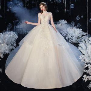 Vintage Szampan Organza ślubna Suknie Ślubne 2020 Suknia Balowa Przezroczyste Wysokiej Szyi Kótkie Rękawy Bez Pleców Aplikacje Z Koronki Frezowanie Trenem Katedra Wzburzyć