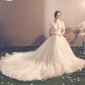 Élégant Champagne Transparentes Robe De Mariée 2019 Princesse Encolure Dégagée Manches Courtes Dos Nu Noeud Appliques En Dentelle Chapel Train Volants