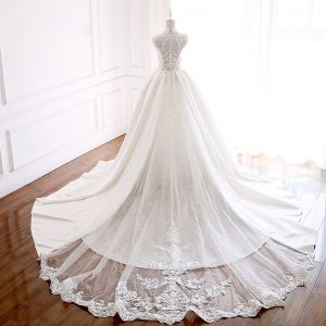Vintage / Retro Ivory Wedding Dresses 2018 Ball Gown High Neck Sleeveless Appliques Pierced Lace Beading Pearl Cathedral Train Ruffle