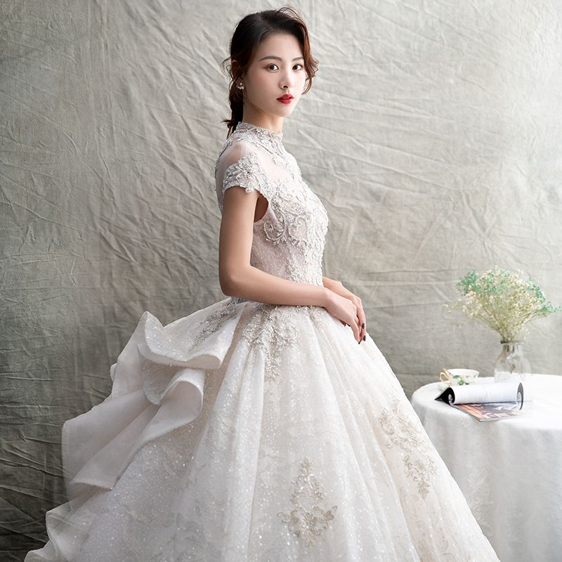Luxury / Gorgeous Ivory See-through Wedding Dresses 2019 Ball Gown High Neck Short Sleeve Backless Appliques Lace Rhinestone Beading Glitter Tulle Cathedral Train Ruffle